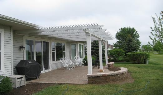 Brick Patio with Seatwall and Pergola