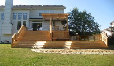 Cedar deck with grand stairs and cedar pergola Crystal Lake IL